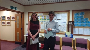 PhD tutor Clare Watt presenting the prize to winner Christoph Kent